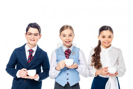 Photo for Happy schoolchildren pretending to be businesspeople with coffee cups Isolated On White - Royalty Free Image