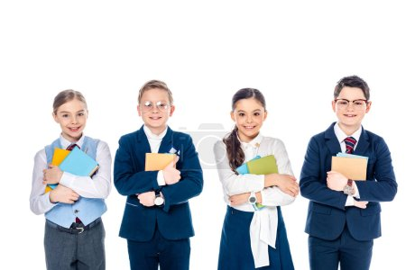 Photo for Happy schoolchildren pretending to be businesspeople with books Isolated On White - Royalty Free Image