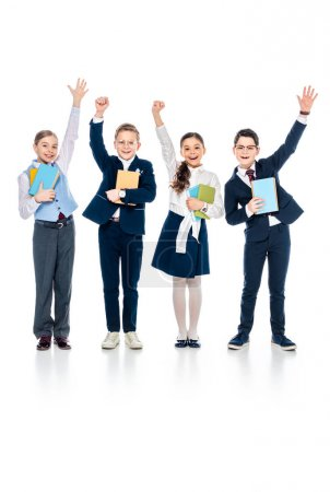 Photo for Happy schoolchildren with outstretched hands holding books On White - Royalty Free Image