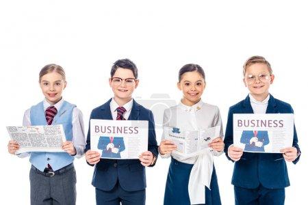 Foto de Escolares sonrientes fingiendo ser empresarios con periódicos mirando la cámara Isolated On White - Imagen libre de derechos