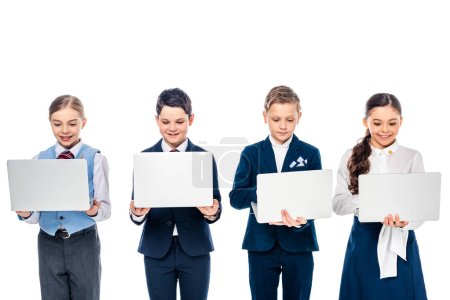 Photo for Schoolchildren pretending to be businesspeople using laptops Isolated On White - Royalty Free Image