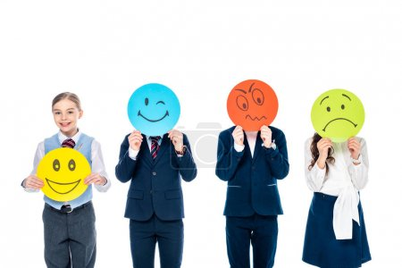 Photo for Kid holding card with happy face while schoolchildren covering faces with cards with various face expressions Isolated On White - Royalty Free Image