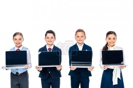 Photo for Schoolchildren pretending to be businesspeople holding laptops with blank screen Isolated On White - Royalty Free Image