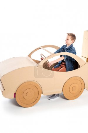 Photo for Adorable boy playing with cardboard car on white with copy space - Royalty Free Image
