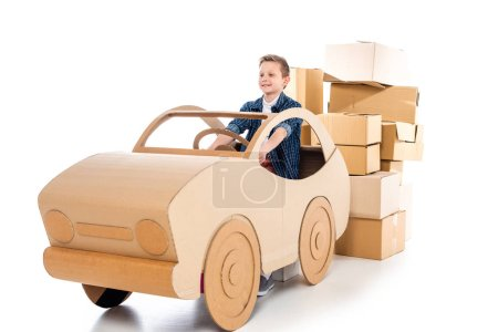 Photo for Happy boy playing with cardboard car on white - Royalty Free Image