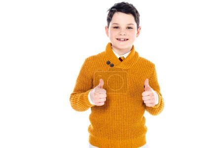 Foto de Smiling boy in casual clothes showing thumbs up isolated on white - Imagen libre de derechos