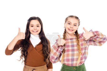 Photo for Happy kids looking at camera and showing thumbs up signs Isolated On White - Royalty Free Image