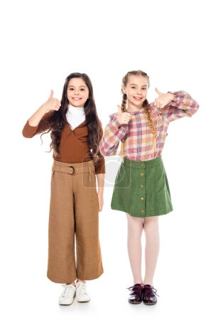 Photo for Happy kids looking at camera and showing thumbs up signs On White - Royalty Free Image