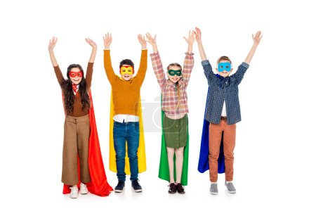 happy kids in superhero costumes and masks with Raised Hands On White