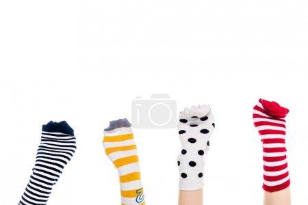 Photo pour Vue partielle des personnes avec des marionnettes chaussettes colorées sur les mains Isolé Sur Blanc avec espace de copie - image libre de droit