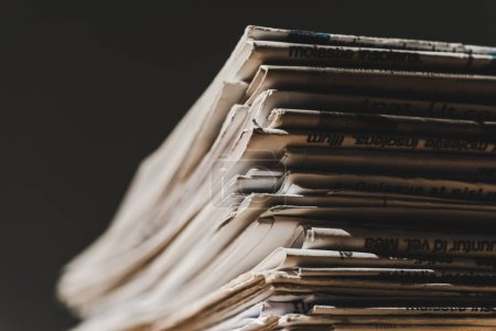 Photo for Different print newspapers in pile isolated on black - Royalty Free Image