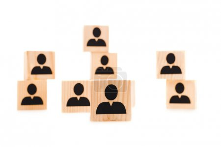 selective focus of wooden blocks with black human icons isolated on white