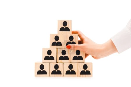 cropped view of woman holding pyramid made of wooden blocks with black human icons isolated on white
