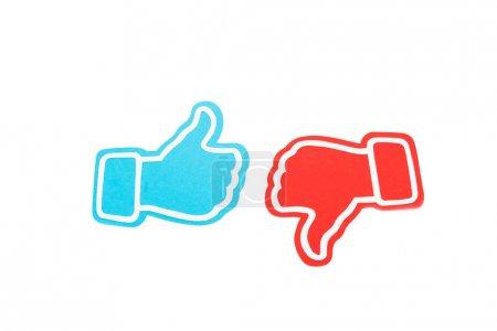 Photo pour Pouce bleu vers le haut et pouce rouge vers le bas signes isolés sur blanc - image libre de droit