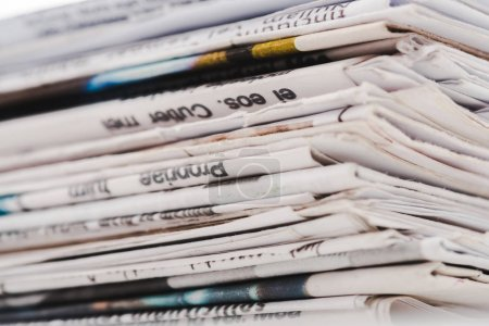 Photo for Close up of different print daily newspapers in stack - Royalty Free Image