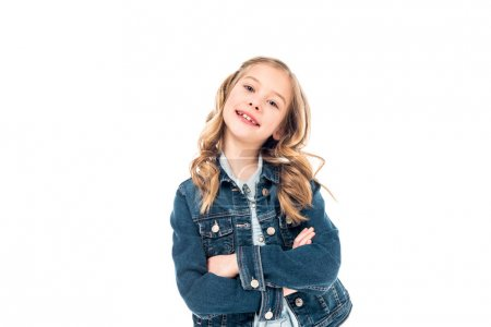 Photo for Kid in denim jacket standing with crossed arms and smiling isolated on white - Royalty Free Image