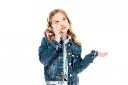 Photo for Kid in denim jacket talking on smartphone and looking up isolated on white - Royalty Free Image