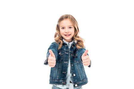 Photo pour Vue avant de l'enfant bouclé dans la veste de denim affichant des pouces vers le haut d'isolement sur le blanc - image libre de droit