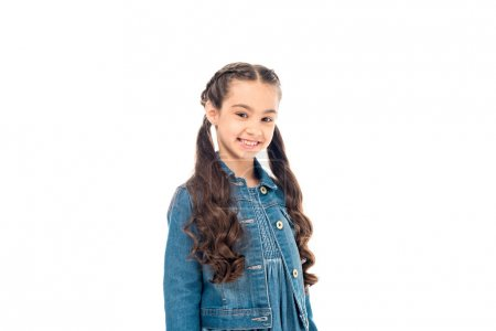 happy kid with long hair in denim jacket looking at camera with smile isolated on white