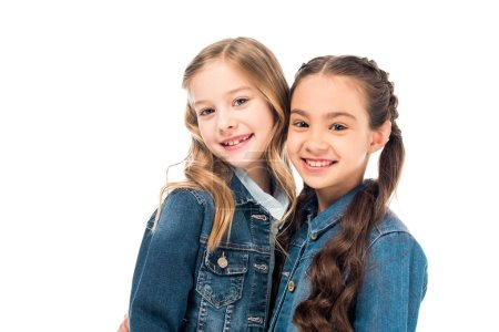 Photo for Two kids in denim jackets looking at camera isolated on white - Royalty Free Image