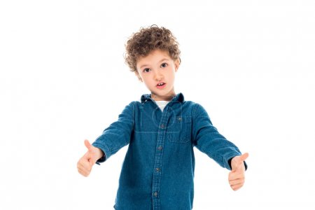 Foto de Emotional kid in denim shirt showing thumbs up isolated on white - Imagen libre de derechos