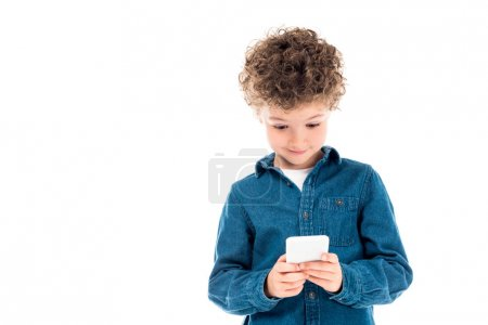 Photo for Cute curly kid in denim shirt using smartphone isolated on white - Royalty Free Image