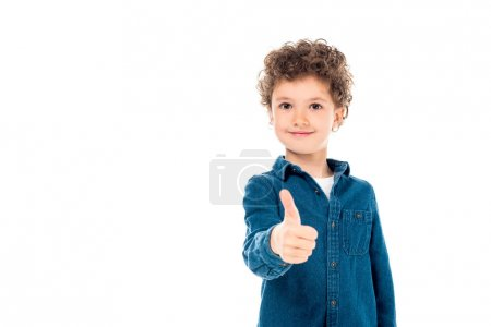 Photo pour Front view of smiling kid in denim shirt showing thumb up isolated on white - image libre de droit