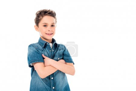 Photo for Smiling kid in denim shirt posing with crossed arms isolated on white - Royalty Free Image