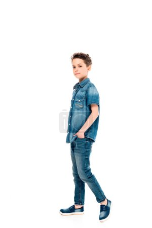 Photo for Full length view of child standing with hand in pocket isolated on white - Royalty Free Image