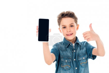 Photo for Front view of kid holding smartphone with blank screen and showing thumb up isolated on white - Royalty Free Image