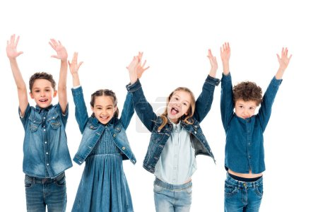 Photo for Front view of four kids in denim clothes smiling with hands up isolated on white - Royalty Free Image