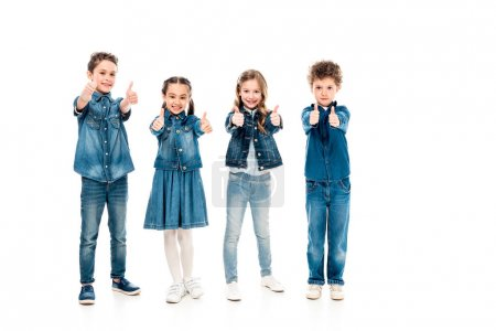 Photo for Full length view of four kids in denim clothes showing thumbs up isolated on white - Royalty Free Image