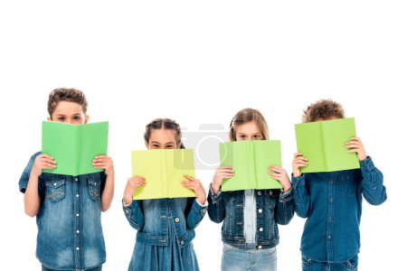 Photo for Four kids in denim clothes holding books isolated on white - Royalty Free Image