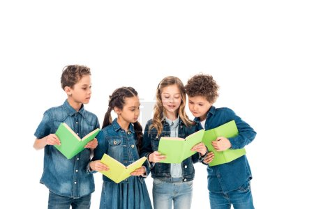 Photo for Four children in denim clothes reading books isolated on white - Royalty Free Image
