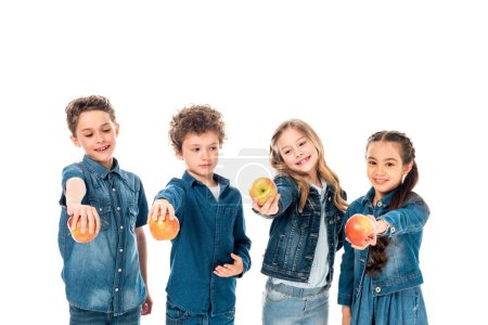 Photo for Four children in denim clothes holding apples isolated on white - Royalty Free Image