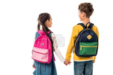 Photo for Back view of schoolchildren with backpacks holding hands isolated on white - Royalty Free Image
