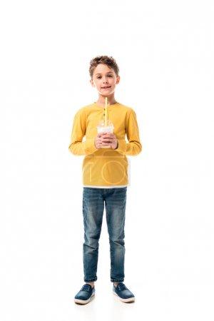 Photo for Full length view of kid holding milkshake isolated on white - Royalty Free Image