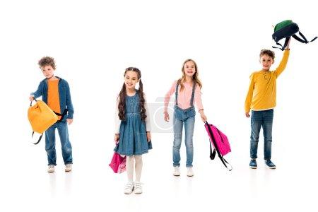 Photo pour Vue pleine longueur des écoliers avec des sacs à dos sur blanc - image libre de droit