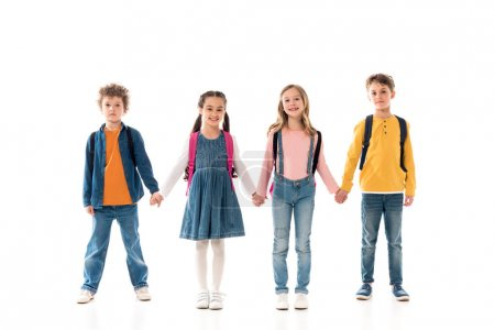 Photo for Full length view of schoolchildren with backpacks holding hands isolated on white - Royalty Free Image