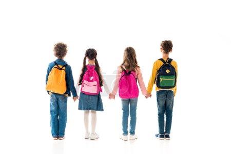 Photo pour Vue arrière des écoliers avec des sacs à dos tenant les mains isolées sur blanc - image libre de droit