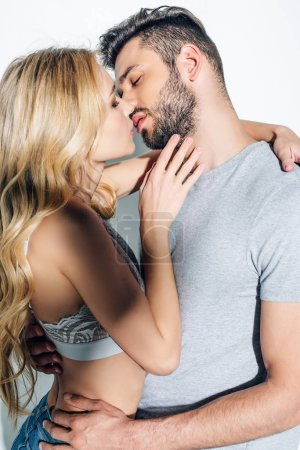 Photo for Attractive blonde woman kissing with handsome man on white - Royalty Free Image