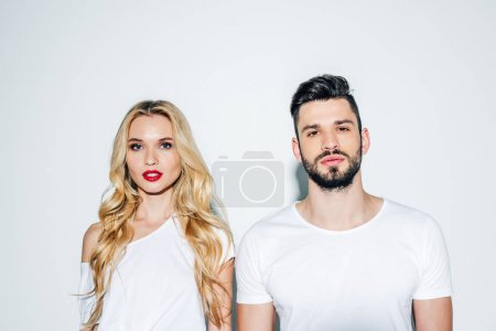 Photo for Bearded man and beautiful blonde girl looking at camera on white - Royalty Free Image