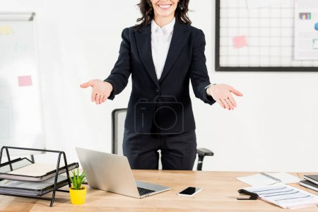 Photo for Cropped view of happy brunette recruiter smiling while gesturing in office - Royalty Free Image