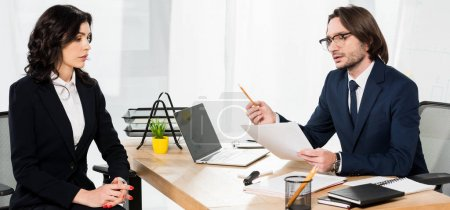 Photo for Panoramic shot of handsome recruiter holding paper near attractive woman with clenched hands - Royalty Free Image