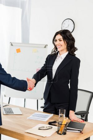 Photo for Cropped view of man shaking hands with happy recruiter in office - Royalty Free Image