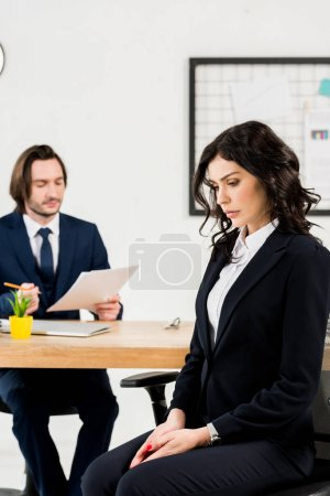Photo for Selective focus of upset woman sitting near handsome recruiter - Royalty Free Image