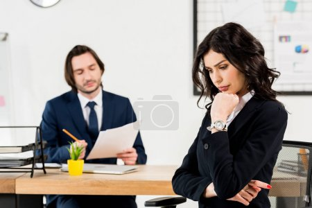 Photo for Selective focus upset brunette woman sitting near handsome recruiter - Royalty Free Image