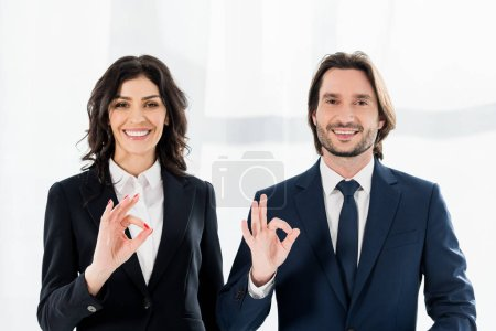 Photo for Cheerful recruiters smiling while showing ok signs and looking at camera - Royalty Free Image