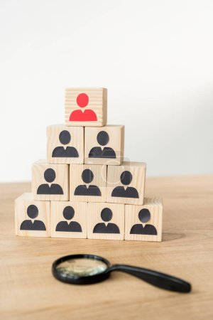 Photo for Selective focus of management hierarchy pyramid near magnifier on white - Royalty Free Image
