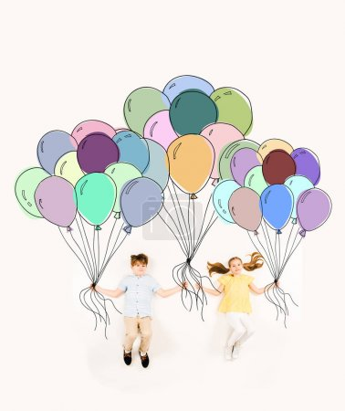 Foto de Cheerful kids holding colorful balloons and flying on white - Imagen libre de derechos